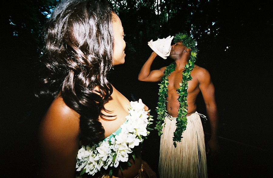 blowing the conch shell for his lover in the forest of Oahu