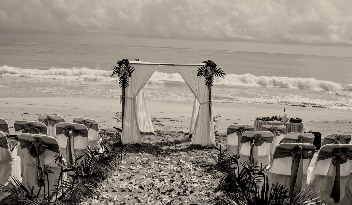 black and white beach wedding in Hawaii with white bamboo archway