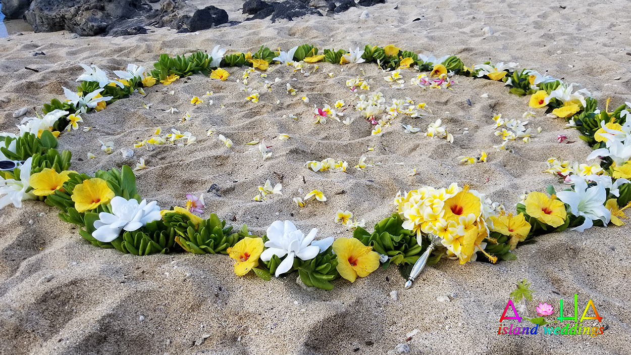 flower circle of Yellow and white flowers on the beach in Hawaii