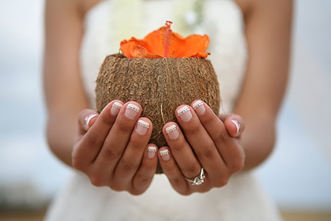 bride holding a coconut with manicure