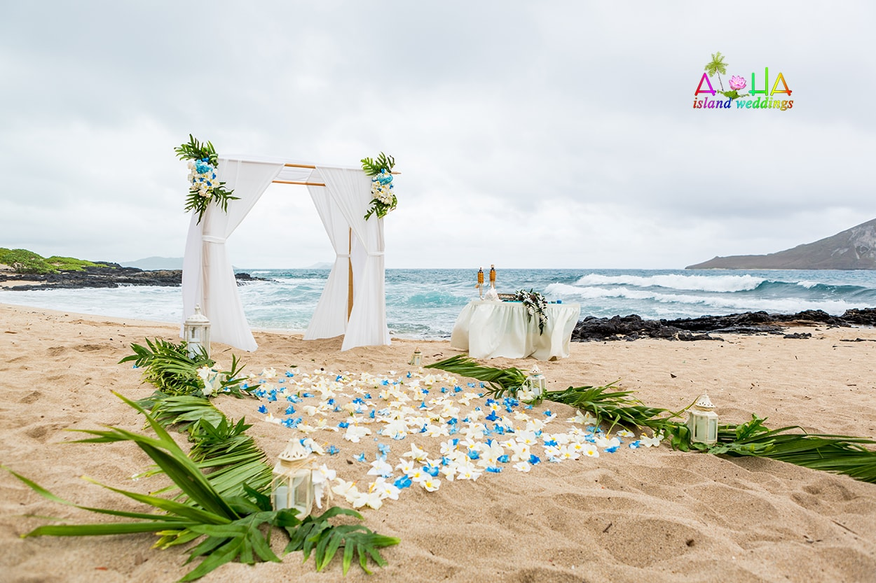 White And Ligth Blue Flowers On The Sand With Candels Palms A Pure