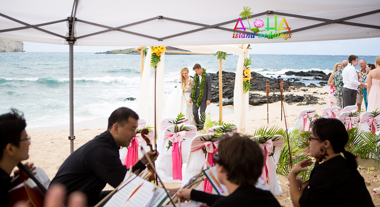 our Hawaii wedding music a quartet 2 violins a vialo and a cello played for me beach wedding ceremony in Hawaii