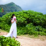 Bride walks with her bouquet down the sandy aisle way of love at this beach wedding in hawaii