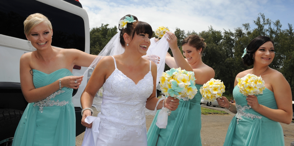yellow plumeria bouquets with bridesmaid and teal blue for the bride